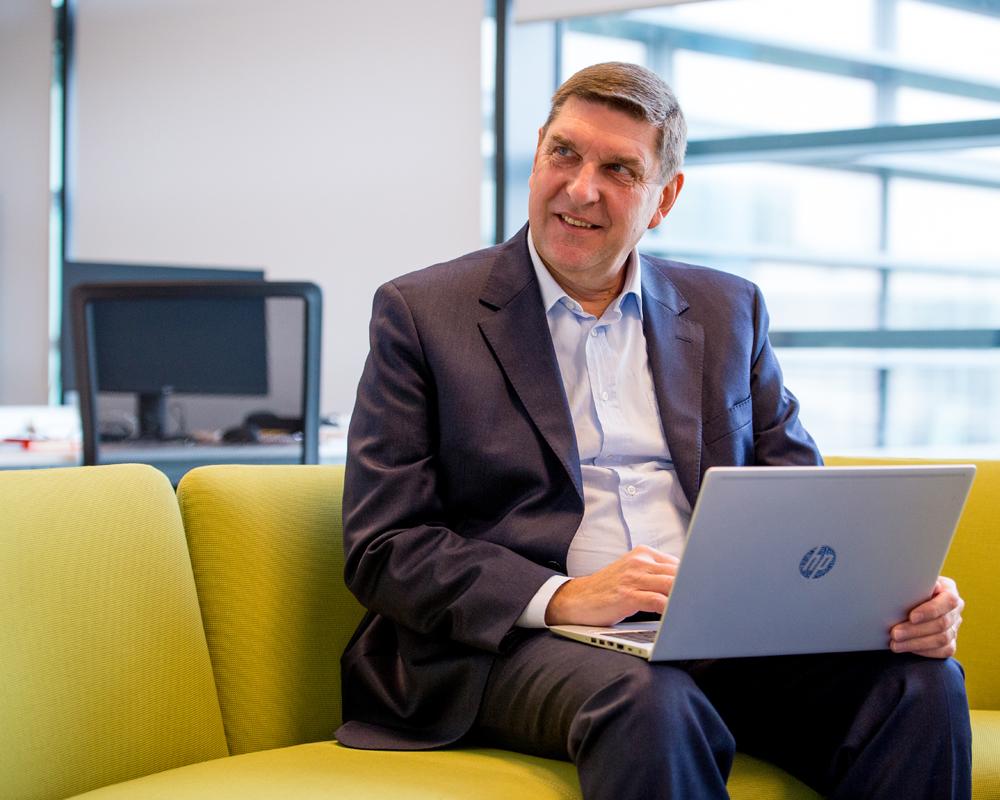 Infor team member on laptop