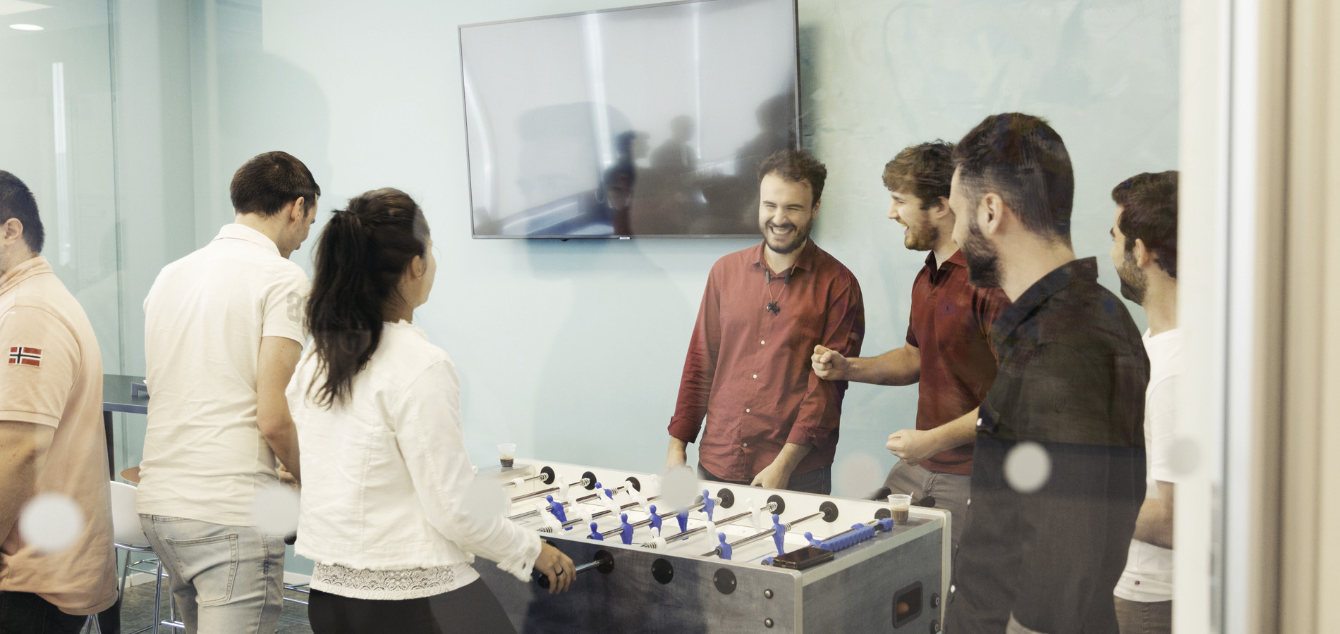 Atlantic team playing table football