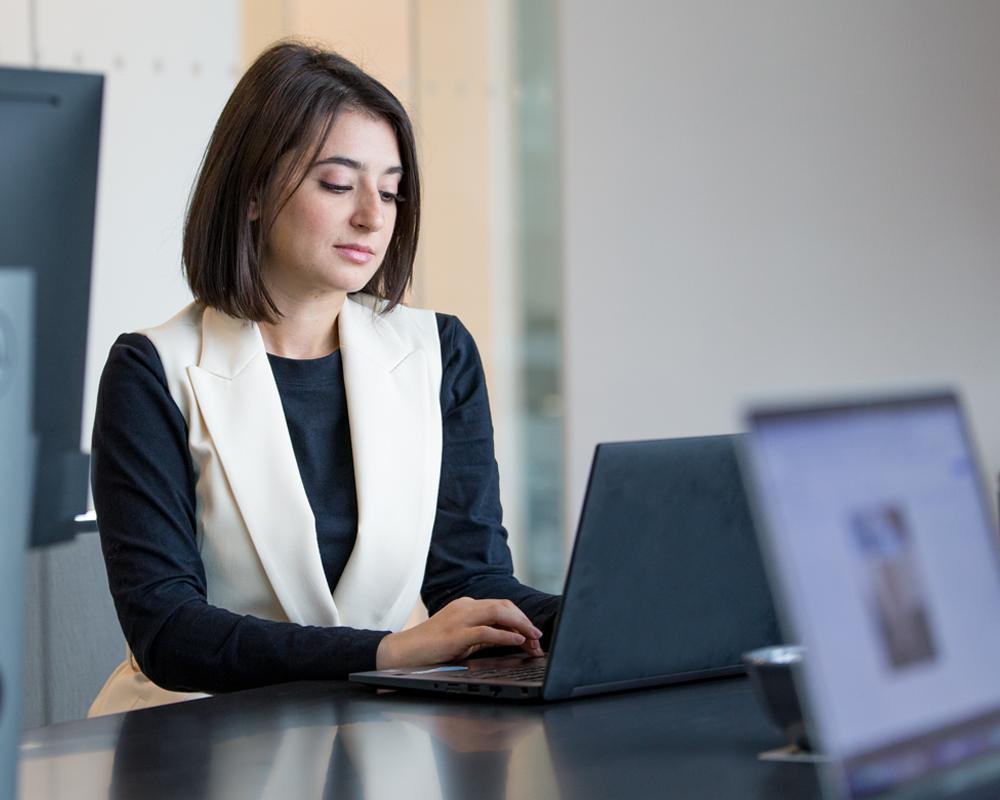 Salesforce CRM team member on Laptop