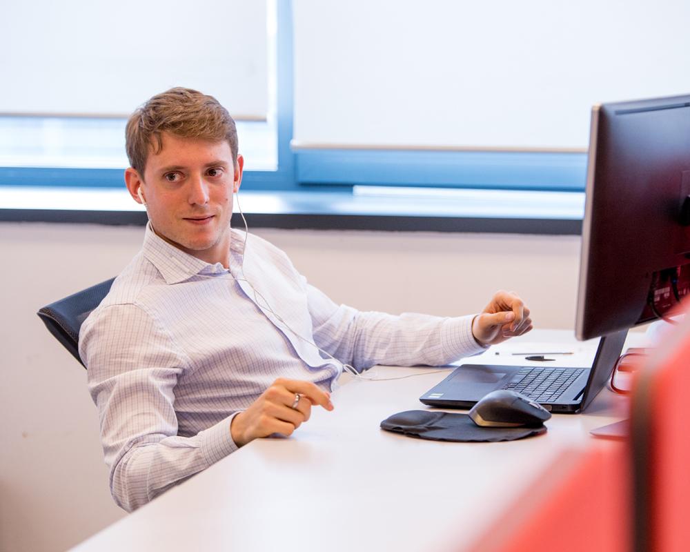 Oracle ERP team member on computer