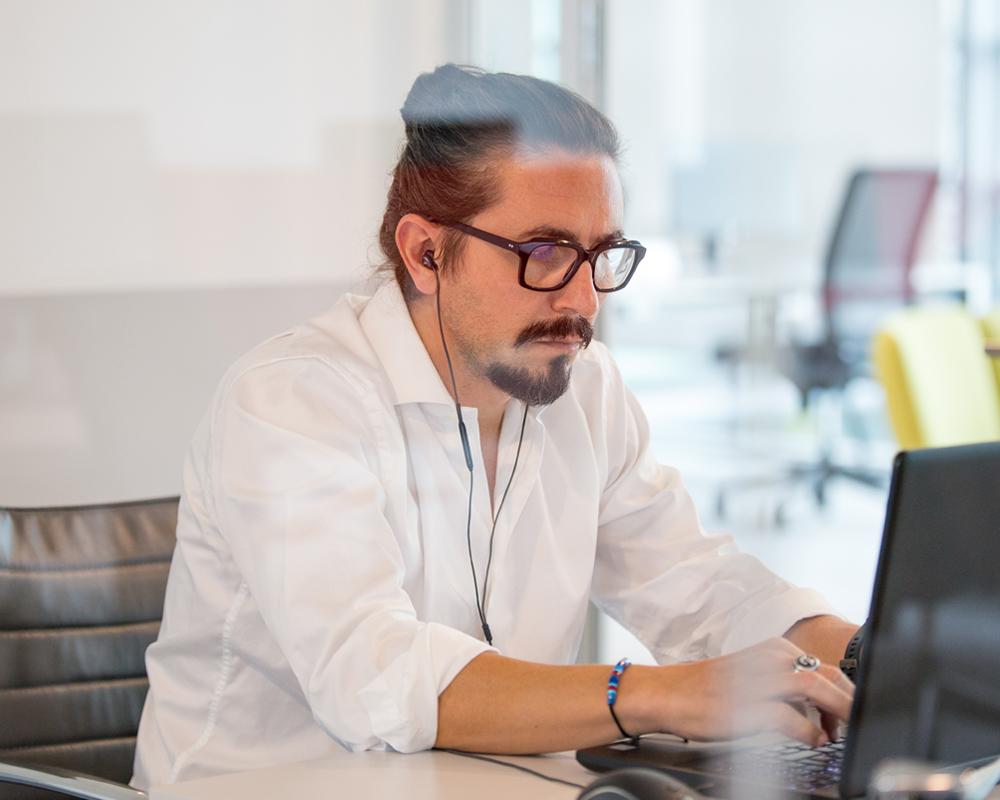 Atlantic team member on computer